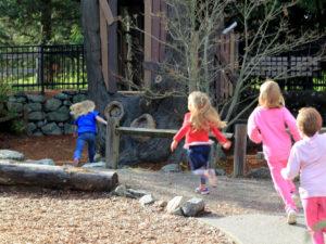 Children running in nature play environment